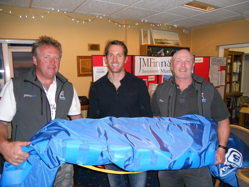 On Saturday evening a prize draw was held for a brand new North Sails Finn sail, sponsored by JM Finn & Co. It was won by a surprised Allen Burrell. Left to Right, Andy Denison, Ben Ainslie, Allen Burrell