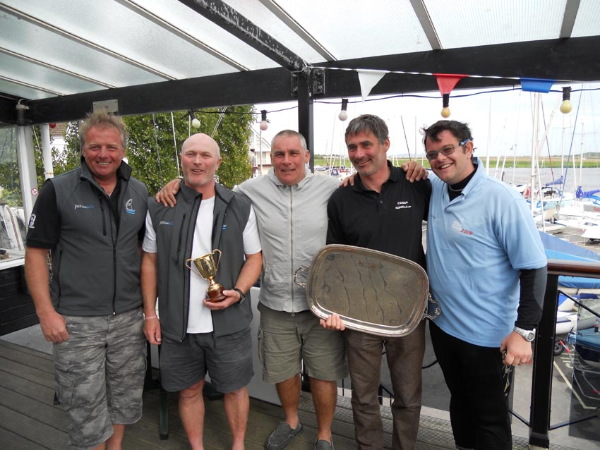 L to R: Andy Denison, Chairman of the British Finn Association, Allen Burrell - National Champion, Rob McMillan - Open Champion, Laurent Hay - second overall, David Higham of JM Finn