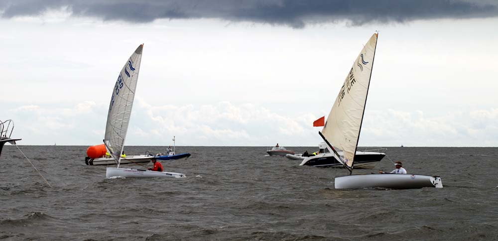 13-7-11-Finn-Race9-kljakovic-gaspic-and-tillander at finish_gal.jpg